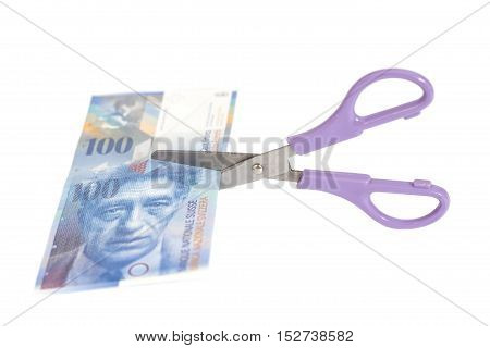 One hundred swiss franc banknotes with scissors.currency of switzerland isolated