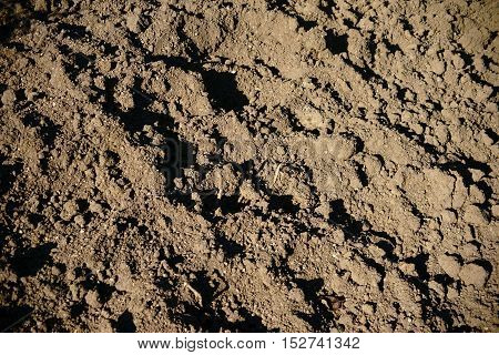 The close up of dug and loosened soil.