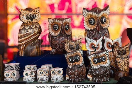 Collection of owl statuettes at market in Marvvao