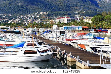 Pier With Moored Boats And Yachts