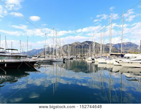 Yachts And Its Reflection In Sea Water