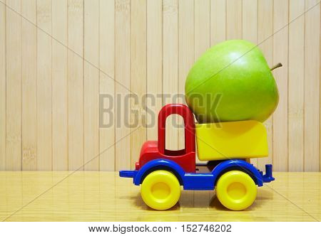 Toy Plastic Car With Green Apple