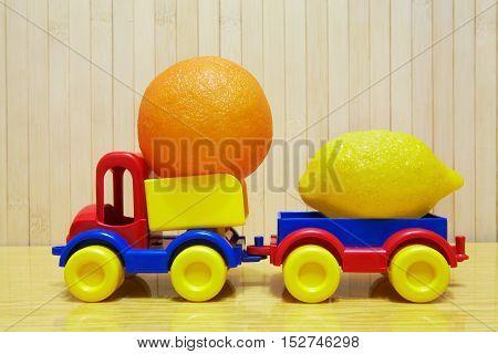 Toy Plastic Car With Lemon And Orange