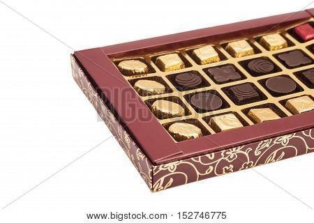 Box of chocolate candies isolated on white