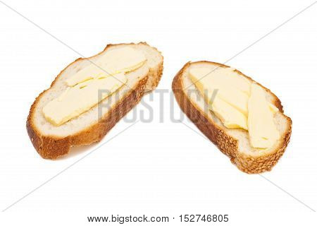 two slices of wheaten bread spreaded with butter