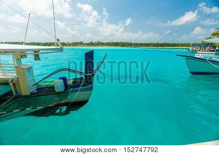 Traditional Boats And The Pier Beside Island, Maldives