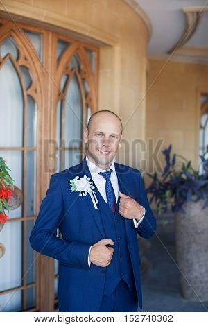 Happy man in a summer wedding day