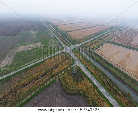 Crossroads Paved Roads Through The Fields. View From Above