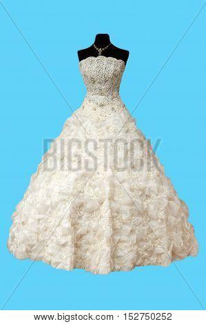 beautiful white wedding dress on a blue background