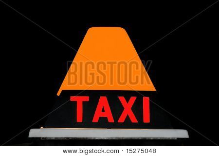 Orange and red Taxicab sign at night