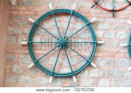 Green Sailboat Rudder hanging on the wall