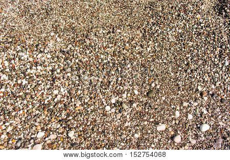 background image of pebbles on a beach
