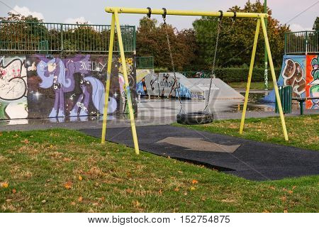 empty tyre swing in the skate park in autum