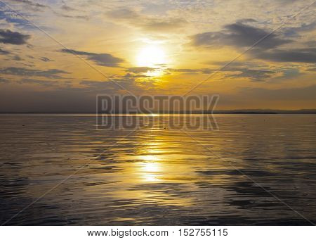 Sunset on the lake, clouds reflected in the water