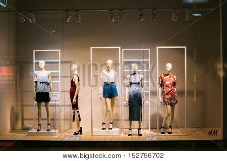 Vilnius, Lithuania - July 08, 2016: Five Mannequins Standing In Store Window Display Of Women's Casual Clothing Shop In Acropolis Shopping Mall.