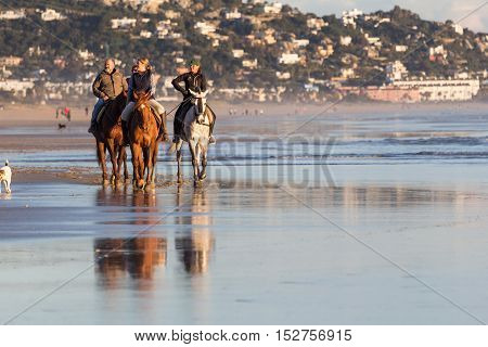 Zahara De Los Atunes, Cadiz, Spain - March 20, 2016: People Having Fun Riding Horses On The Beach