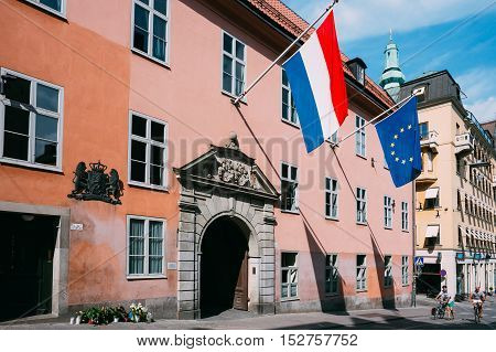 Stockholm, Sweden - July 29, 2014: French Tricolours Flag And Flag Of The European Union Decorate Building Of The Streets Of Stockholm, Sweden