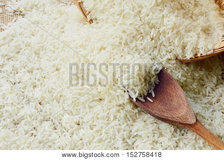 close up from rice with wooden background