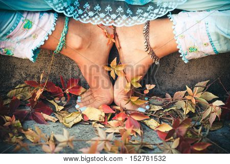 closeup of barefoot woman feet in yoga position outdoor shot