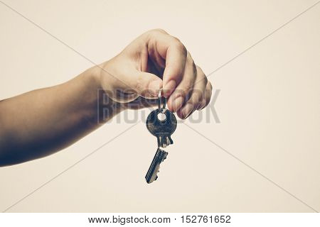 Closeup of hand holding a broken key isolated / Success and failure concept