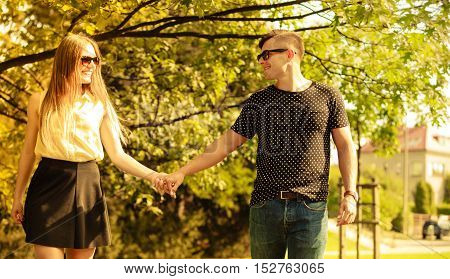 Couple Taking Walk Through Park.