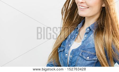 Smiling Cute Girl With Denim Top.