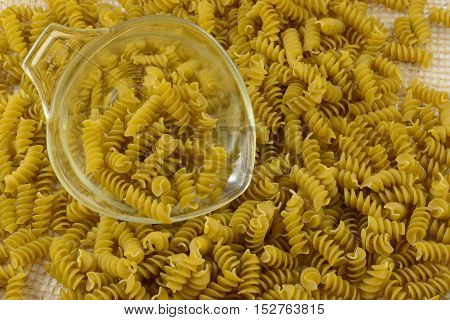 Vegetable Rotini pasta made with spinach and zucchini puree ad glass measuring cup