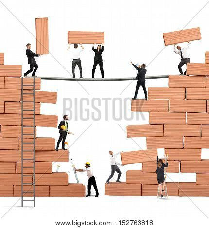 Business person built together a big brick wall