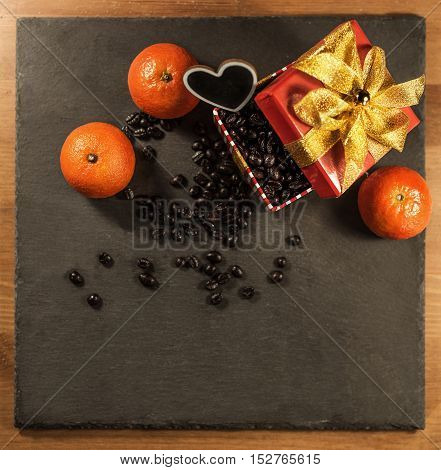 present with coffee decorated and accompanied with tangerines on black stone