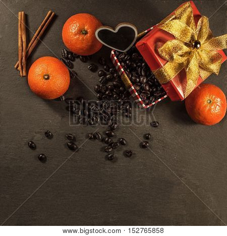 present with coffee decorated and accompanied with cinnamon and tangerines on black stone