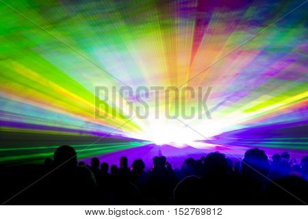 Rainbow laser show. Very colorful show with a crowd silhouette and great laser rays on pyrotechnic festival.