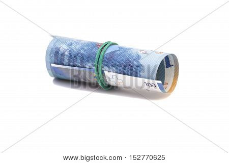 Swiss francs in a roll on white background