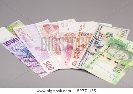 International currencies isolated on a gray backgrond