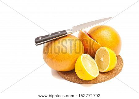 Knife with orange and lemons on white background