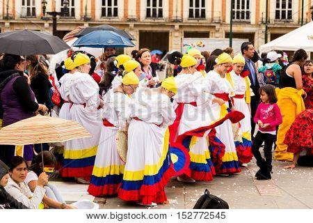 BOGOTA, COLOMBIA - NOV 16: Colombian traditional dance in Bolivar Square on November 16, 2013 in Bogota, Colombia.