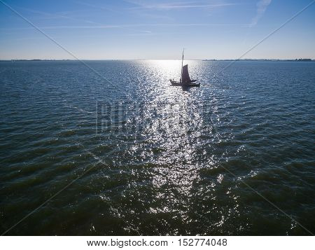 Aerial view of single sail at sea