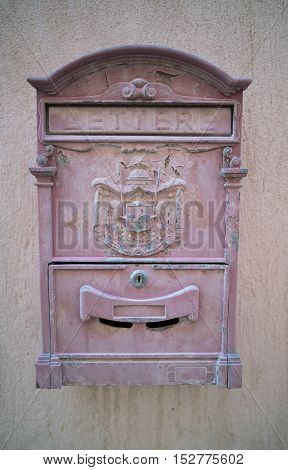 Beautiful old mailbox hanging on the wall
