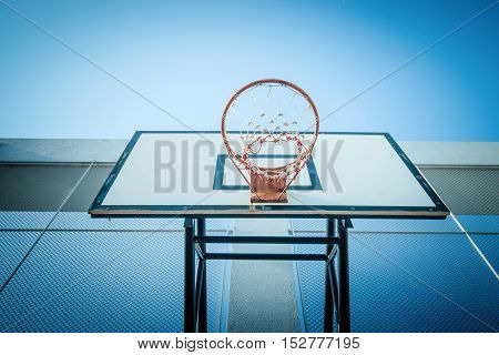 Basketball hoop at blue sky for play