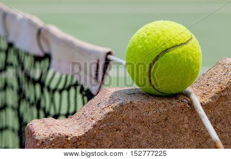 Tennis Ball on the rock Court Close up