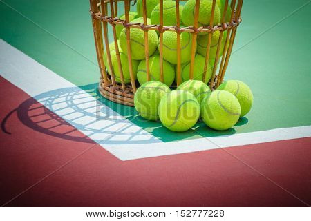 Tennis Ball with Racket on old basket tennis court, and net