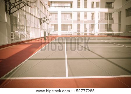 BANGKOK THAILAND-APRIL 12 2016Tennis court and basketball at a top building hotel with shadow and vintage in Thailand on APRIL 12 2016.