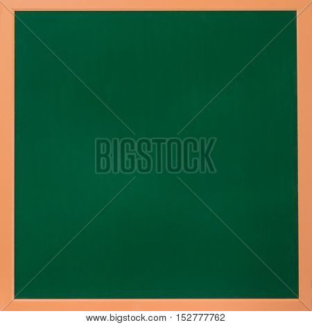 a blank school green board in wooden frame in classroom for an education or school concept and advertising background
