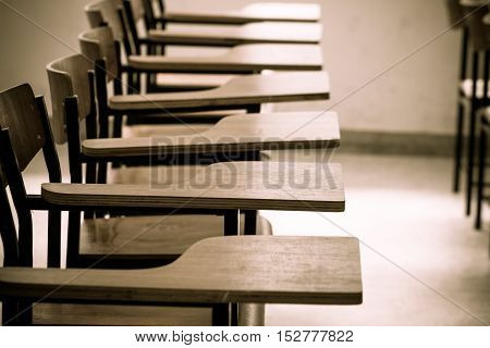 Chair in empty classroom lecture armchairs in school