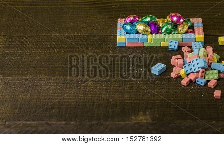 Easter eggs composition on black rustic wooden table