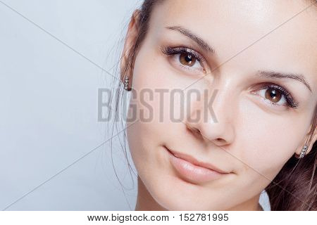 Young woman beauty portrait. Natural soft make up. Beauty Woman face Portrait. Beautiful Spa model Girl with Perfect Fresh Clean Skin. brunette female looking at camera Youth and Skin Care Concept.