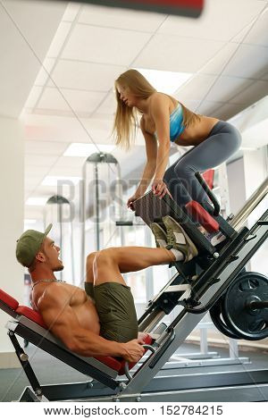 At gym. Athletes having fun while practicing on simulator