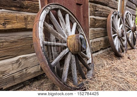 Old wagon wheels against a wall at a museum in Winthrop Washington.
