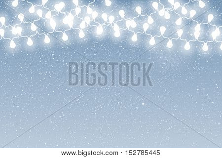 Falling snow vector. White splash on blue background. Winter snowfall hand drawn spray texture. Garland on the background of snow-covered sky.