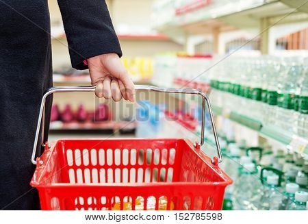 Pretty young woman buying in a supermarket/mall/gr ocery store