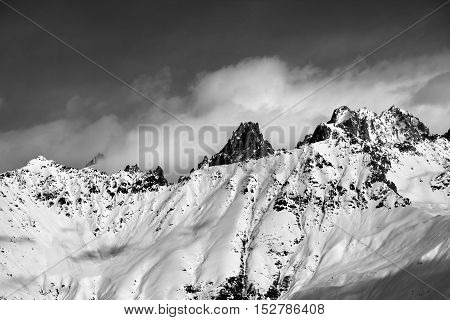 Black And White Snow Avalanches Mountainside In Clouds